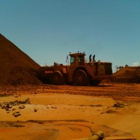 Heavy-equipment-undertaking-stock-pile-maintenance-